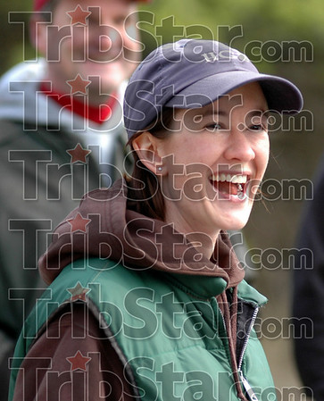 "Humor: Kate Yegerlehner laughs as she listens to her father give final instructions to volunteers of the annual ""cattle drive""."