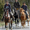 Ride 'em cowboy: Jasper Mount, Troy Schmitt and Pierre Schmitt, all of Clay City, Indiana trail along behind the herd to chase any cattle that break away from the drive.