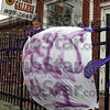 Eel backer: Danielle Flora stands by her handmade banner in front of her Pizza Gallery in Clay City.