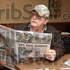 Been there: Tim Rood of Clay City looks over the sports section of the Tribune-Star, reading about the Eels sectional win Saturday night. Rood was  on the 1973 Clay City sectional championship team.