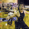 "Ham it up: Jason Osajima ""hams"" for the camera during the demonstration Friday evening at the Washington Center."