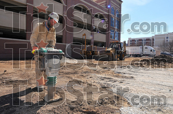 Ground work: Richard Ridge of S&G Excavating compacts the ground where the east end of the new arch will be at Seventh and Cherry Streets.