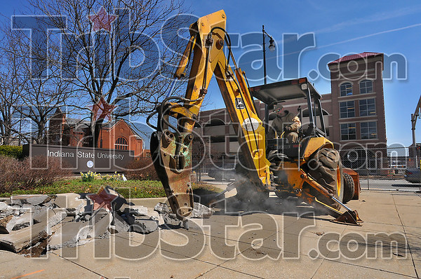 Clearing out: Jon Burnett breaks up concrete at the present entryway to the ISU campus at Seventh and Cherry Streets. He is preparing the ground for the new arch over Seventh Street that will welcome people to the campus.