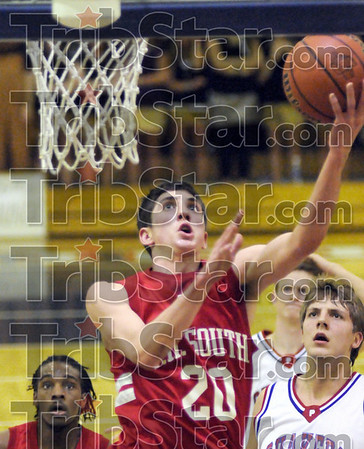 Score: South's #20, Ian McIntyre drives the the basket to score during first half action against Plainfield Friday night.