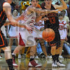 Stingy: Lion Trey Brashear defends against Paris' Zach Henn in second quarter action Friday night in Robinson.