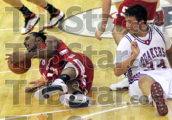 Scramble: South's #11, Chris Rose goes to the floor for a loose ball during game action against Plainfield Friday night.