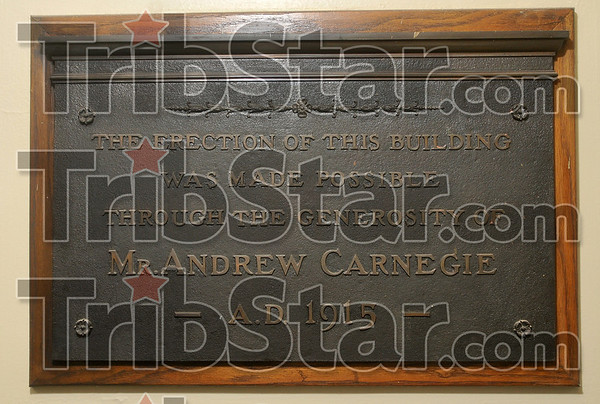 Tribune-Star/Joseph C. Garza<br /> Remembering his beneficence: This plaque honors the contribution of Andrew Carnegie and is inside the entrance of the Rockville Library.