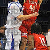 Too tall: Rockville's RJ Mahurin blocks a shot by Brave Lemuel Young late in their Saturday night game in Hulman Center.