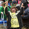 Tribune-Star/Joseph C. Garza<br /> Shiverin' for a good cause: A member of the St. Patrick's Shivering Shamrocks Polar Plunge team shouts as she walks through the icy water Saturday at Hulman Center.