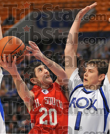 Tough defense: Defense way tough all night long between Terre Haute South and Rockville. Here Ian McIntyre finds RJ Mahurin in his way.