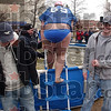 "Tribune-Star/Joseph C. Garza<br /> Ready to make a big splash: A Polar Plunge participant known as ""Billy Bob"" climbs on the pool ladder before diving in Saturday at Hulman Center."