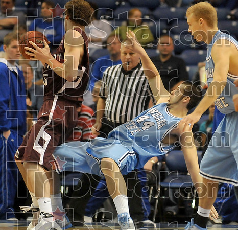Tribune-Star/Joseph C. Garza<br /> Taking one for the team: Indiana State's Jay Tunnell draws the charge against Missouri State's Wade Knapp during the Sycamores' win Saturday at Hulman Center.