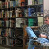 "Tribune-Star/Joseph C. Garza<br /> A good place to wait: Library patron Bill Hahn reads David Baldacci's ""Divine Justice"" in the Rockville Public Library Tuesday as he waits for a mechanic to fix his car."