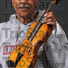 "Tribune-Star/Joseph C. Garza<br /> Made by Pop: Howard Tichenor holds a violin hand made by his great uncle, (but who he still called ""Dad"") Frank Tichenor. Howard was raised by Frank who made several violins by hand."