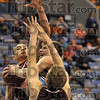 Tribune-Star/Joseph C. Garza<br /> Hard drivin': Indiana State's Aaron Carter tries to drive between two Missouri State defenders during the Sycamores' 69-52 win Saturday at Hulman Center.
