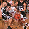 No easy baskets: Terre Haute South's Jake Odum tries to dribble around Bloomington South's David Blackwell during the Braves' 66-39 loss