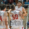 Semifinal victory: Terre Haute South's Ian McIntyre is hugged by teammate Ike Worrell after the Braves defeated Evansville Harrison in the semifinal of the Seymour regional Saturday.