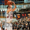 Extending the lead: Terre Haute South's Ian McIntyre shoots a freethrow with 4.7 seconds on the clock at the end of the Braves' semifinal victory over Evansville Harrison Saturday in the Seymour regional.