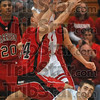 In demand: Terre Haute South's John Michael Jarvis and Evansville Harrison's Joseph Lee reach for a loose bass as Jarvis' teammate, Jake Odum, looks on after diving on the floor for it Saturday during the Seymour regional semifinal.