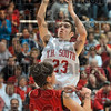 Spin and shoot: Terre Haute South's Jake Odum takes a shot over Evansville Harrison's Chase Boberg during the Braves' Seymour seminfinal win Saturday.