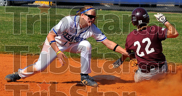 In time: ISU shortstopMere Simpson tags Missouri State baserunner Jessie Smith well before she can reach second base.
