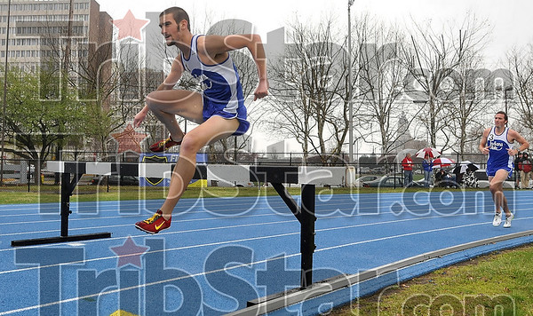 Tribune-Star/Joseph C. Garza<br /> Keeping the lead: Indiana State's Michael Disher leads all runners as he clears one of the hurdles in the 3,000-meter Steeplechase Saturday during the Indiana State Track & Field Invitational at Marks Field.