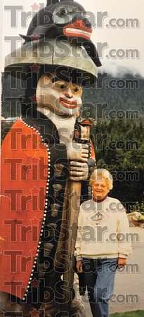 Up North: Marilyn Pendergast poses by a carved figure during a trip to Alaska.