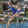Tribune-Star/Joseph C. Garza<br /> First one over: Indiana State's Erica Moore clears a hurdle as she leads all her competitors and teammates in the 100-meter hurdles Saturday during the Indiana State Track & Field Invitational at Marks Field.