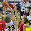 Contested: Mooresville's Matt Kenney tries to shoot over the defense of Jacob Tanoos in first half action.