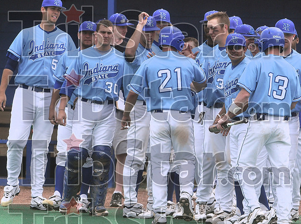 Tribune-Star/Joseph C. Garza<br /> A good day at the office: Indiana State's Brady Shoemaker (21) is congratulated by teammates after he hit a three-run home run during the Sycamores' win Wednesday over Butler at Sycamore Field.