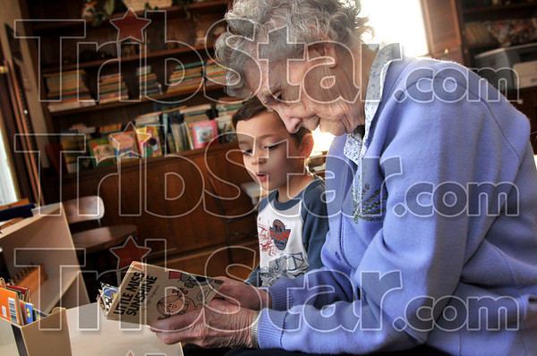 Tribune-Star/Joseph C. Garza<br /> Temporary location, same education: Montessori School Director Frances Murphy works with pupil, Peter Yacoub, 5, on his reading skills Wednesday at the school's temporary home on Margaret Avenue, west of 25th Street. The school's regular home on south 11th Street was heavily damaged by the June floods.