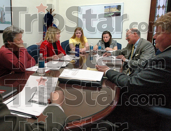 Cabinet meeting: Members of president's cabinet meet with interim presidents Hannah Biggs (yellow) and Rebecca Tracy (3rd from left) Tuesday afternoon. Board members present are Vicki Kosowsky, Cattie King, Don Stahl, Art Criss and Gordon Afdahl.
