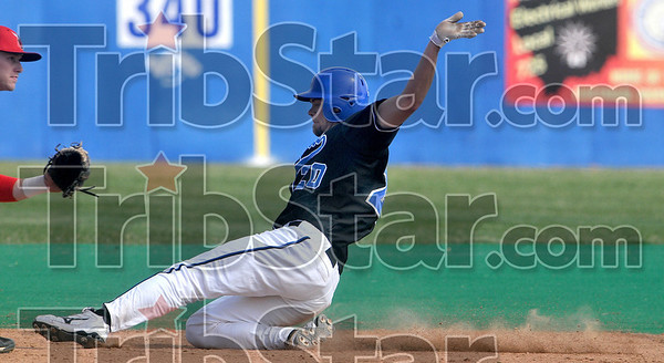 Tribune-Star/Joseph C. Garza<br /> Safely sliding: Indiana State's Nick Ciolli beats the throw to second as the Ball State second baseman waits for it during the Sycamores' game against the Cardinals Wednesday at Sycamore Field.