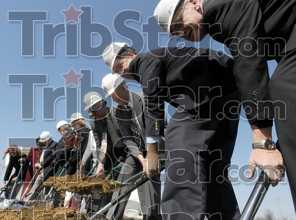 Can you dig it?: Credit Union, construction and other invited guests take part in a ground-breaking for the new building Wednesday afternoon.