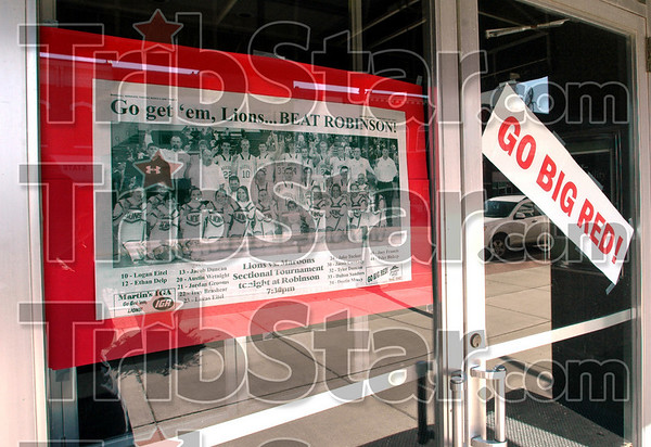 Go Lions: Businesses along Archer street in Marshall support the Lions basketball team.