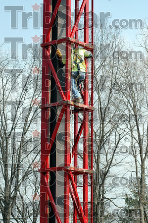 Adjustment: An ironworker climbs inside a pile driver to make an adjustment Monday afternoon at the location of the crossing of Lost Creek near Maple Avenue.