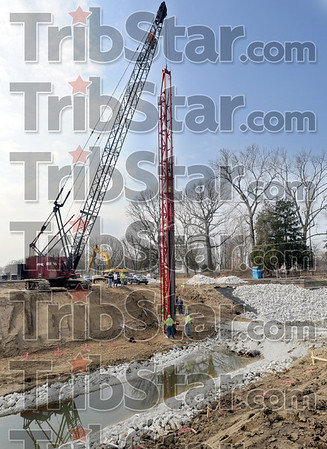 Pile driver: Construction crews  put the first piling into place along Lost Creek near Maple Avenue Monday afternoon.