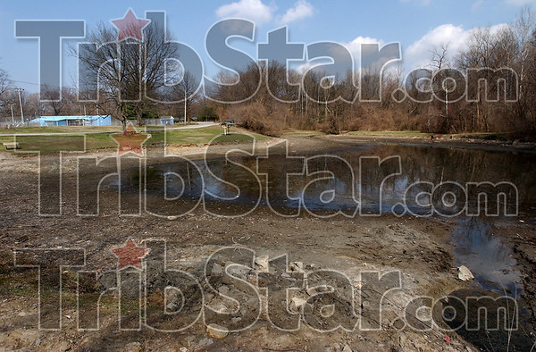 Fixer upper: The back pond at Dening park has ben drained prior to being cleaned up and dredged. Terre Haute Parks Deparment superintendant Eddie Bird said he wanted the area to look better for when the hiking and biking trail is built between Deming and Dobb's Park.