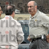 In custody: Vigo Co. School superintendent Danny Tanoos, Ray Azar and Detective Sgt. Frank Shahadey of the Vigo Co. Sheriff's department talk just minutes after taking a man into custody in North Terre Haute Tuesday afternoon.