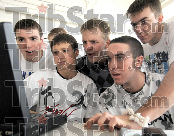 Stats: Members of the Clay City boy's basketball team look at statistics on the coache's computer just prior to leaving for Martinsville for practice Tuesday evening.