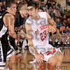 Tribune-Star/Joseph C. Garza<br /> Can't handle him: Terre Haute South's Jake Odum shakes a couple of Bloomington South defenders during the Braves' regional championship game at Seymour March 14.