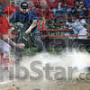 In a cloud of dust: Marshall pitcher #10 Logan Eitel shows the ball to the umpire after tagging John Dayton of Paris (located somewhere in the cloud of dust) as he attempted home plate on a passed ball during game action Tuesday night. Dayton was called out on the play.