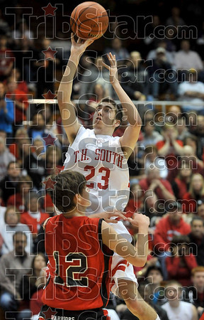 Tribune-Star/Joseph C. Garza<br /> Height advantage: Terre Haute South's Jake Odum shoots over Evansville Harrison's Chase Boberg during the Braves' regional semifinal win Saturday, March 14 in Seymour.