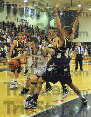 No way in: Thomas Anderson finds his way blocked by Mooresvile defender Marty Broderick