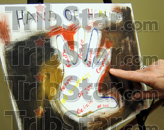 Hand of Healing: Detail photo of artwork on display at the Hux Center Center.