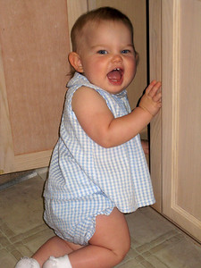 """Plaing in """"her"""" cabinet at Grandma's"""