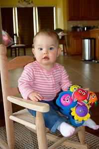She got in that rocking chair with her singing flowers all by herself!