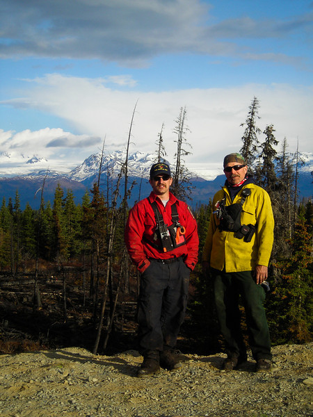 Greg Adamietz and Bowzr Diaz pose for a portrait in front of the Homer Scenery.