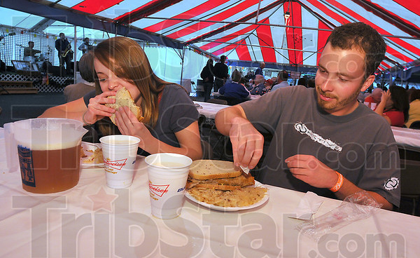 Hearty meal: Friends Rozie Montgomery and Stephen Castor enjoy a meal of schnitzel with all the trimmings at the Strassenfest Thursday night.