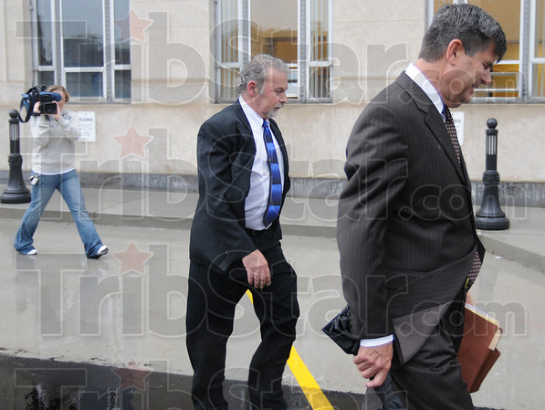 Finished: David Decker follows his attorney William Smock as they leave the Federal Courthouse Thursday morning after an appearance to sign a plea agreement with prosecutors.